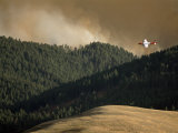 Firefighting Plane Prepares to Drop Retardant on a Forest Fire Photographic Print by Gordon Wiltsie