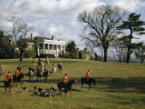 Fox Hunters on Horseback and Hounds Amble across Mansion's Front Lawn Photographic Print by Justin Locke