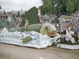 Men and Women Ride on Fish Float in Aquatennial Parade Photographic Print by Jack Fletcher