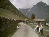 Norwegian Girls Seated Along a Dirt Road, Lined with a Stone Fence Photographic Print by Gustav Heurlin