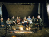 Park Ranger Talks to Tourists Sitting Beside a Campfire at Night Photographic Print by Robert Sisson