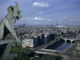 Gargoyle on Notre Dame Looks Down on a Densely Packed Cityscape Photographic Print by Justin Locke