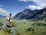 Hiker Stands on Rocky Ledge Overlooking Valley Below Mount Sebastopol Photographic Print by Howell Walker