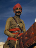 Man with a Distinguished Mustache and Red Turban on Horseback Photographic Print by Volkmar K. Wentzel