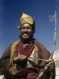 Yellow Hat Lama Holds Bow and Arrow Used in Sports, Not Hunting Photographic Print by Volkmar K. Wentzel