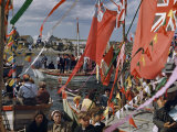 People Fill Boats Draped in Flags at Blessing of the Boats Photographic Print by Andrew Brown
