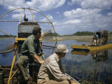 Men Ride Air Boats in Shallow Marshes Photographic Print by Willard Culver