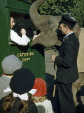 Asian Elephant Asks for Treat from Truck Driver While Children Watch Photographic Print by Volkmar K. Wentzel