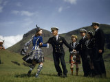American Midshipman Twirls a Kilted Highland Dancer to Bagpipe Music Photographic Print by B. Anthony Stewart