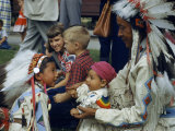 Native American Father and His Children Rest after Dancing Photographic Print by Ralph Gray