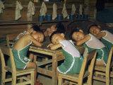 Seated Refugee Boys Rest their Heads on their Arms for a Nap Fotografisk trykk av Joseph Baylor Roberts
