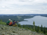 Men Survey Wilderness Terrain from a Hill Overlooking a Lake Photographic Print by Andrew Brown