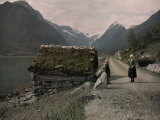 Two People Stand on a Dirt Road Along a Fjord Leading to Mundal Photographic Print by Gustav Heurlin