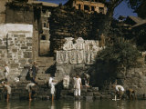 Men Wash Rugs in Jhelum River and Hang Them on Rocks to Dry Photographic Print by Volkmar K. Wentzel