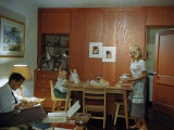 Married Student Studies as His Wife Serves Dinner to their Daughter Photographic Print by Volkmar K. Wentzel