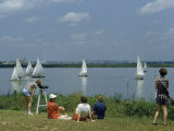 People Watch Sailboats Crossing Finish Line at Urban Marina Photographic Print by B. Anthony Stewart