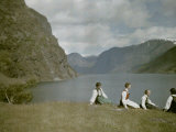 Norwegian Women in Traditional Dress Relaxing in a Scenic Fjordland Photographic Print by Gustav Heurlin