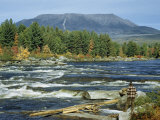 Man Standing on Riverbank at Abol Falls Looks Toward Mount Katahdin Photographic Print by Robert Sisson