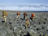 Scientists Struggle to Cross Boulder Field Surrounding Crater Lake Photographic Print by Richard Hewitt Stewart