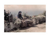 Elderly Woman Sits on a Stone Wall Among Many Different Flowers Photographic Print by Wilhelm Tobien