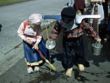 Boy and Girl Wearing Dutch Costumes Wash Street During Tulip Festival Photographic Print by Andrew Brown