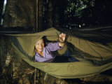 Woman Closes a Mosquito Net on a Hammock Photographic Print by Richard Hewitt Stewart