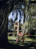 Servants Walk across Lawn in Front of Brick Plantation House Photographic Print by Volkmar K. Wentzel