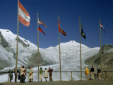 Tourists Look at Glacier from Overlook, Flags Honor Foreign Visitors Photographic Print by Volkmar K. Wentzel