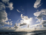 Beach with Gentle Surf under a Sky Filled with Puffy Clouds Photographic Print by Norbert Rosing