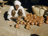 Sidewalk Merchant Polishes Stock of Ablution Jars Photographic Print by W. Robert Moore