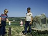 Young Boy Puts a Note into a Message Tube on Spirit Mound Photographic Print by Ralph Gray