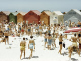 Afrikaners Relax on a Sunny, Cabana-Lined Beach Photographic Print by Dr. Gilbert H. Grosvenor