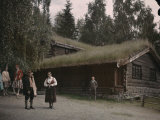 People at Lillehammer's Open-Air Museum Display of Norse Buildings Photographic Print by Gustav Heurlin