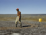 Scientist Drags a Magnet across Tundra to Pick Up Ore Particles Photographic Print by Richard Hewitt Stewart