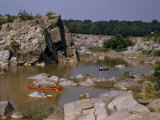 Men Paddle Canoes on a Tranquil Backwater Above Great Falls Photographic Print by Walter Meayers Edwards