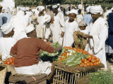 Customers Bargain with Vegetable Vendors at an Outdoor Market Photographic Print by W. Robert Moore