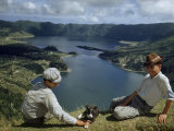 Men with Puppy Overlook Hourglass-Shaped Lakes in Volcanic Crater Photographic Print by Robert Sisson