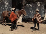 Two Cowboys Stand with a Horse in Chile Photographic Print by Jacob Gayer