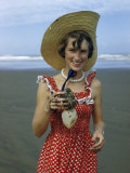 Teenage Girl Holds a Toheroa, a Marine Clam Native to New Zealand Photographic Print by Howell Walker