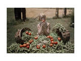 Girl Eating a Tomato, Sits Among the Vegetables from a Garden Photographic Print by Edwin L. Wisherd