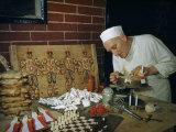 Pastry Chef Decorates a Cake Near Other Edible Sculptural Creations Photographic Print by Volkmar K. Wentzel