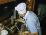 Man Wearing a Chef's Hat Grills Steaks in a Sailboat's Tiny Galley Photographic Print by Robert Sisson