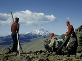 Skiers Gaze across Volcanic Wastes to Snowcapped Ngauruhoe Volcano Photographic Print by Howell Walker