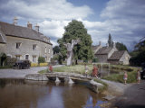 Children Cross a Stone Bridge in Front of Stone Cottages Photographic Print by Melville Grosvenor