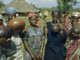 Women Wearing Patterned Dresses and Scarves Make Music with Gourds Photographic Print by W. Robert Moore