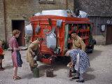 Villagers Buy Oil from Traveling Salesman by His Truck of Wares Photographic Print by Melville Grosvenor
