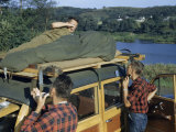 Camper Sleeping on Station Wagon Roof Awakes to Find Friends Shaving Photographic Print by Walter Meayers Edwards