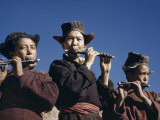 Schoolboys Wearing Homespun Robes and Hats with Ear Flaps Play Flutes Photographic Print by Volkmar K. Wentzel