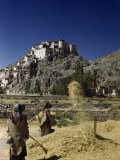 Women Winnow Barley in Valley Below Monastery Built on Crag Photographic Print by Volkmar K. Wentzel