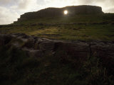 Sunlight Glows Through an Opening in a Wall of Ancient Dun Aengus Photographic Print by  xPacifica